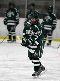Everett Ma 02/18/2012 Billerica player #7 Kate Piacenza (cq) heads out to line up for the playing of the National Anthem. Billerica High vs Everett High girls hockey. Staff / Photographer: Jonathan Wiggs Reporter:Section:North : Reporter:Slug: